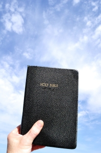 holding Bible up